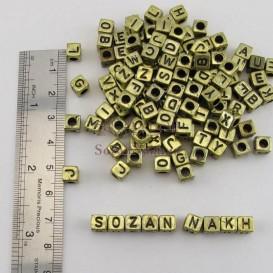 مهره پلاستیکی مکعب الفبا طلایی سایز 6